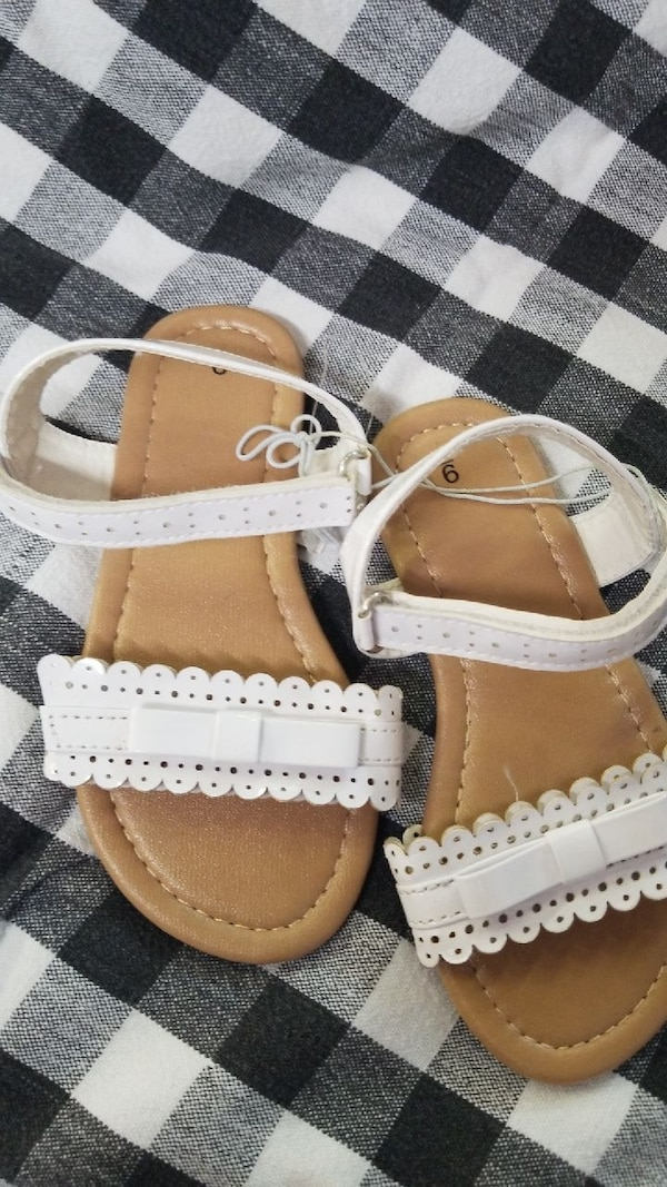 pair of brown-and-white leather sandals