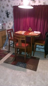 Table with 4 chairs and sofa and recliner