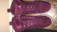 pair of maroon suede high-top sneakers