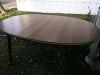 oval brown wooden dining table Louisville, 40258