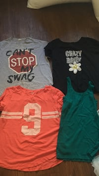 Three assorted-color crew-neck t-shirts and one green tank top