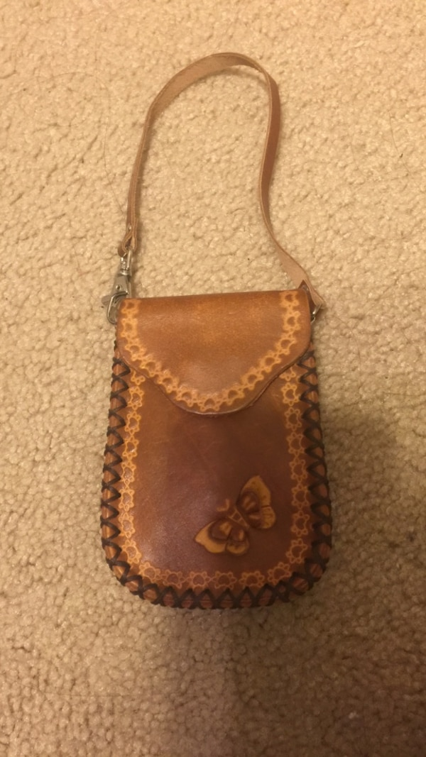 98ec7d526e76c Used Brown and beige floral butterfly accent pouch bag wallet for sale in  Chandler - letgo