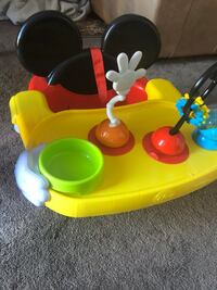 baby's yellow and green activity saucer 4 mi