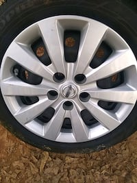 chrome Ford 5-spoke wheel with tire