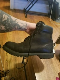 pair of black leather work boots tims