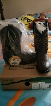 pair of brown leather cowboy boots with box