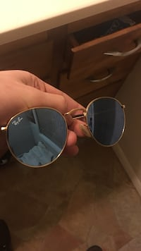 blue Ray-Ban sunglasses with gold frame
