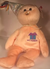 white and pink dressed doll 799 mi