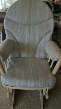 beige wooden framed grey padded glider chair