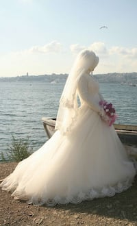 women's white long sleeves wedding gown