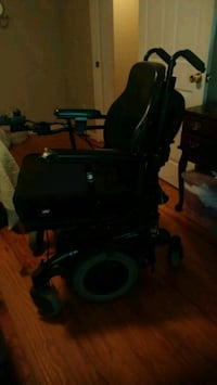 black and grey power wheelchair