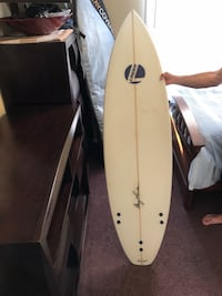 white and black surf board Oceanside, 92056