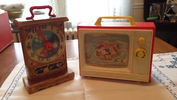 White and red plastic TV and brown analog clock toys