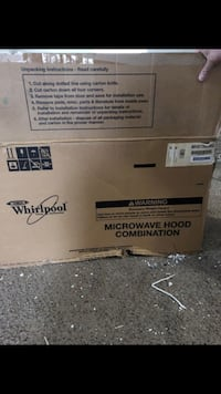 White microwave in the box brand new  Hyattsville, 20784