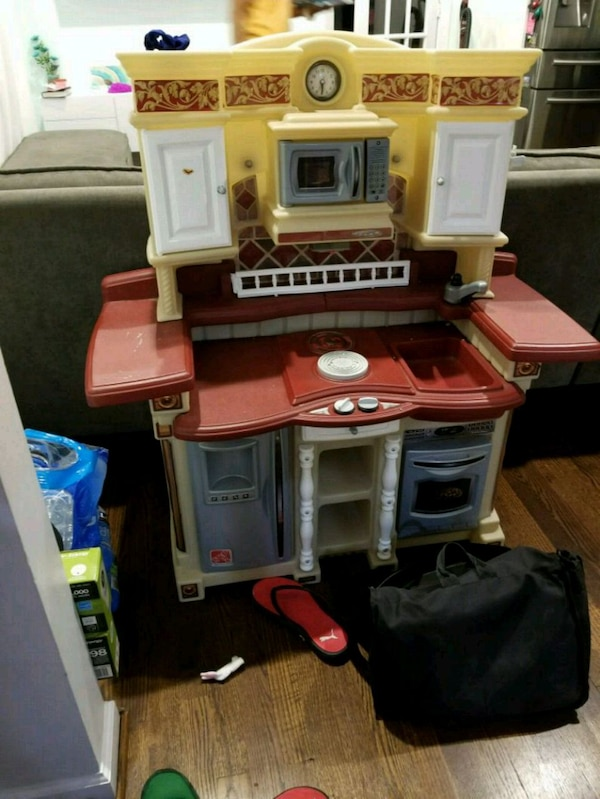 white, red, and gray kitchen playset