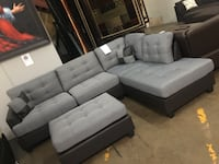 Grey fabric sectional with ottoman. Brand new.  Lewisville