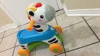White and blue fisher-price zebra ride-on toy