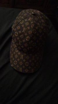 Brown and white louis vuitton leather cap Winnipeg, R3E 0Z7