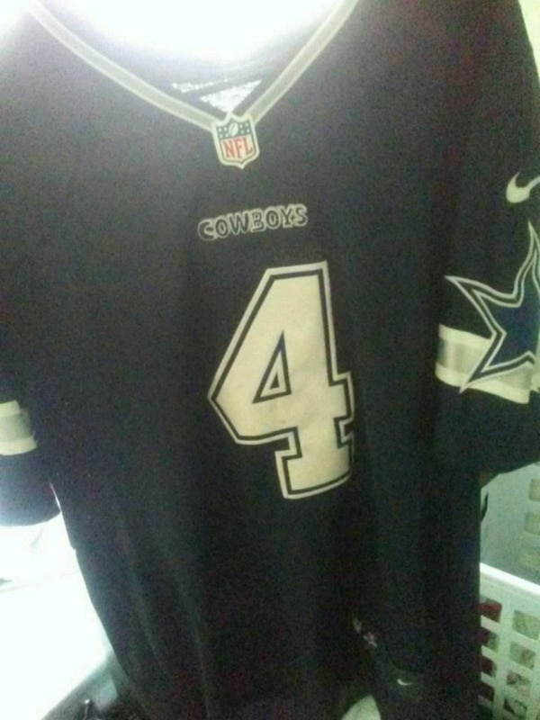 blue and white NFL # 4 jersey