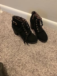 pair of black suede lace-up boots