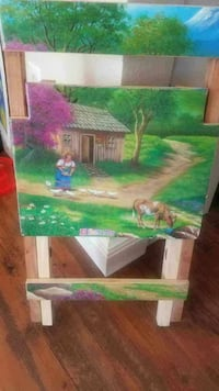 girl near the cow and house painting