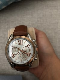 round silver chronograph watch with brown leather strap Toronto, M3C 3Z6