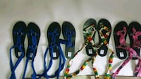 three pairs of blue and black flip flops Laval, H7M
