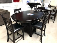 round black wooden table with four chairs dining set Houston, 77084