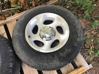 """Aluminum rim with tire. 16"""" from Ford Explorer. Fits other five lug Ford and Mercury vehicles. Has center cap. Lots of tread on Goodyear tire. Knoxville, 37931"""