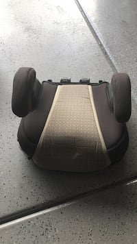 baby's brown and black booster seat
