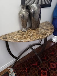 Marble side table with tall vases