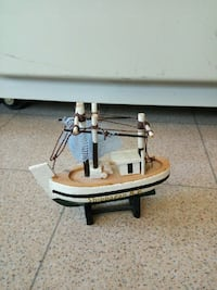 white and black sailing boat miniature