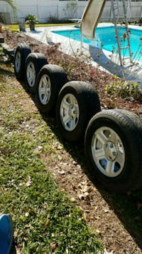 5 Jeep tires/wheels 4 Dunlop 235/70/16  and Goodyear Wrangler spare