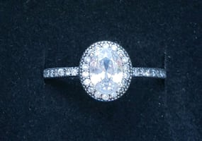 Oval sterling silver engagement ring with halo