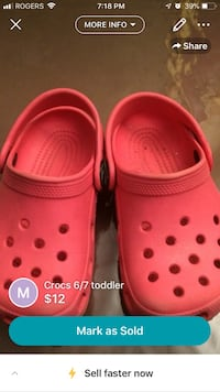 pair of red Crocs clogs Montréal, H1R 1M6