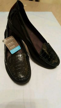 pair of black crocodile leather flat shoes