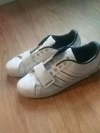 pair of white leather low-top sneakers Winnipeg, R3B 1T4
