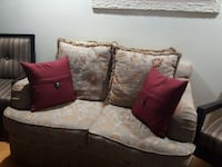 gray and brown floral fabric 2-seat sofa with throw pillows Orlando, 32819