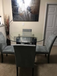 Glass round table with 4 chairs/ can also sell separately  Takoma Park, 20912