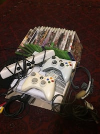 white Xbox One console with controller and game cases Brampton, L7A 2W3