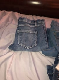 two blue and gray denim bottoms 75 km