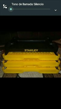 three yellow Stanley plastic containers
