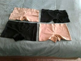 Panties 2 black 2 flesh/tan coloured. Size small.