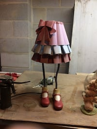 pink and white skirt with mary janes shoes table lamp
