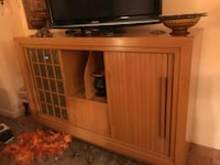 brown wooden TV stand with flat screen television New York, 10022