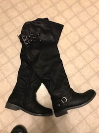 Pair of black leather round-toe thigh-high boots