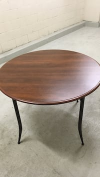 Round brown wooden dining  table Toronto, M6J 0B9
