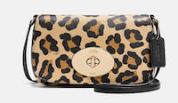 """Brand New Coach with Tag Liv Cross body In Ocelot Print Cross grain Leather. Turn lock closure, fabric lining; Outside open pocket. Still wrapped in package 8 3/4"""" (L) x 5 1/4"""" (H) x 1 1/2"""" (W) Paid $230 plus tax, in smoke free Brampton"""