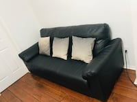 Black leather ikea couch in  good condition looking to sell it fast.. Vaughan, L6A 3A5