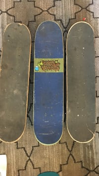 Three blue and black skateboards
